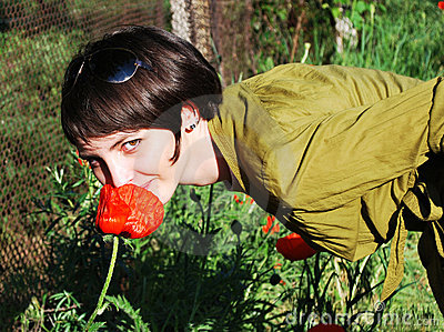 Girl with red poppy