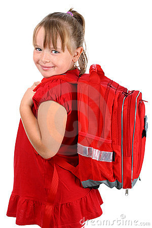 Girl with red school bag smiling isolated on white