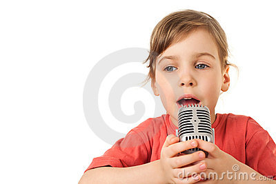 Girl in red sing in old style microphone
