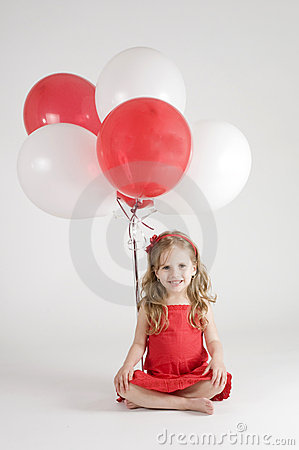 Girl with red and white balloons