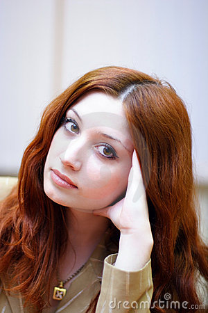 Girl with reddish hair in office