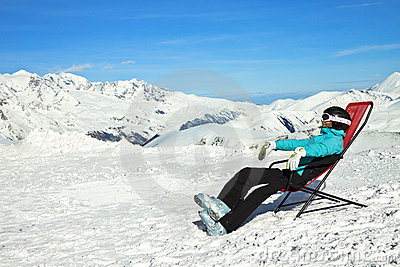 Girl relax in snowy mountains