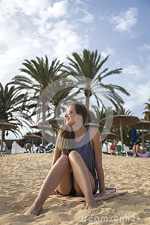 Free Girl Relaxes On A Beach Stock Image - 63122851