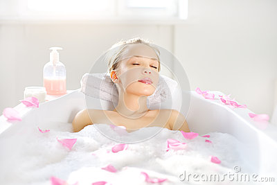 Girl relaxing in bath