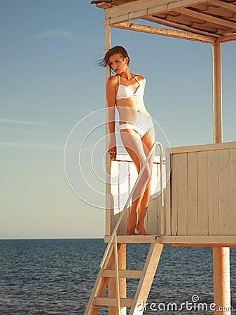 Girl relaxing in a beach gazebo