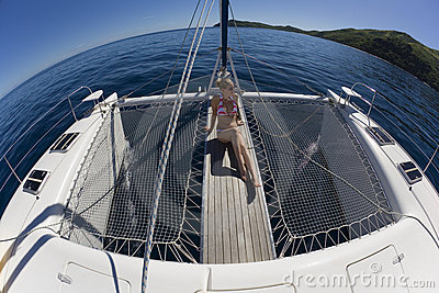 Girl relaxing on a catamaran - South Pacific