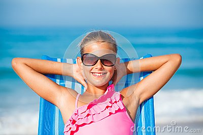Girl relaxing on deck chair