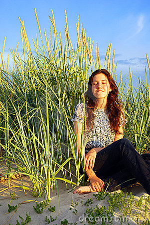 Girl relaxing on the dunes