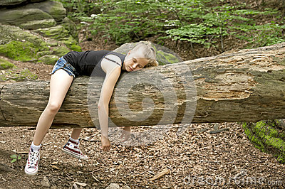 Girl relaxing in forest