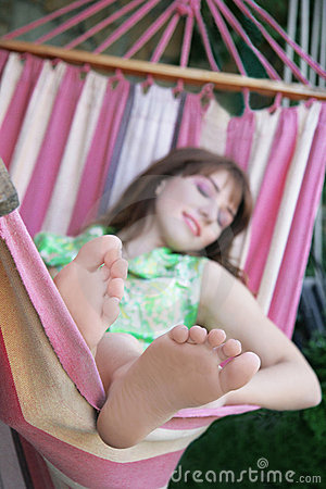 Girl relaxing in hammock