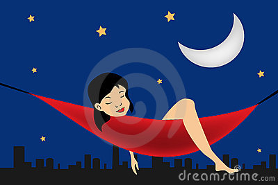 Girl relaxing in a hammock on city background