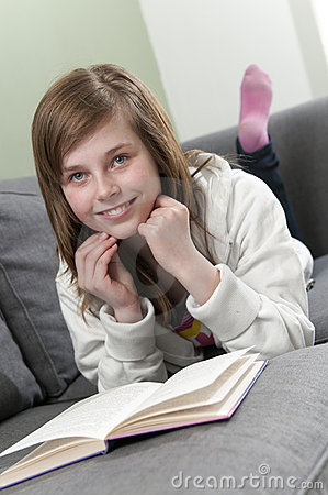 Girl relaxing at home and reading