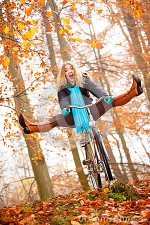 Free Girl Relaxing In Autumnal Park With Bicycle Stock Photography - 58092022