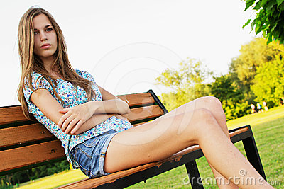 Girl relaxing on park bench