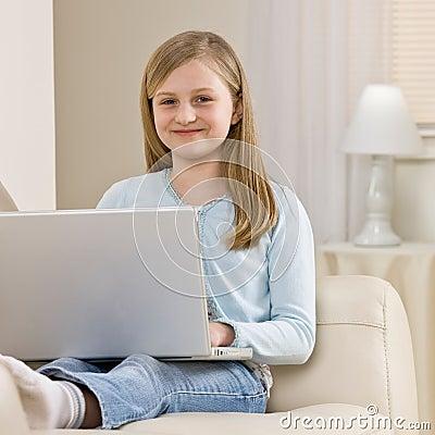 Girl relaxing on sofa in livingroom