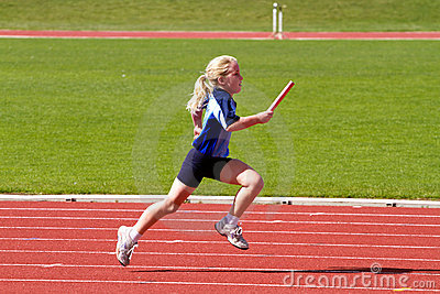 Girl in relay sports race Editorial Stock Image