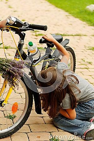 Girl repairing bike