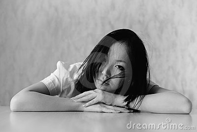 Girl rest on table