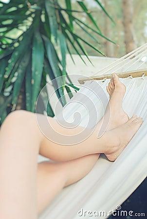 Girl resting in a hammock.