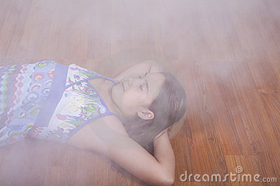 Girl resting on the living room floor