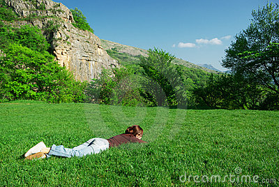 Girl resting on the meadow