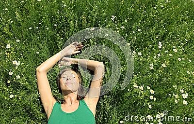 Girl resting in Meadow