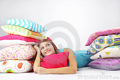 Girl resting on pillows