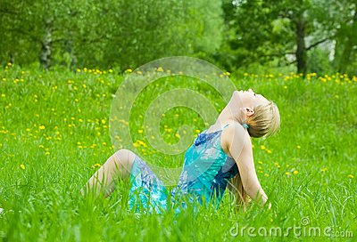 Girl rests on the grass