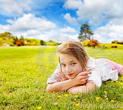 Girl rests in sunny meadow