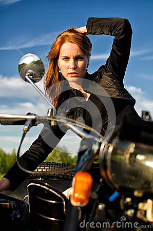 Girl on retro motorbike