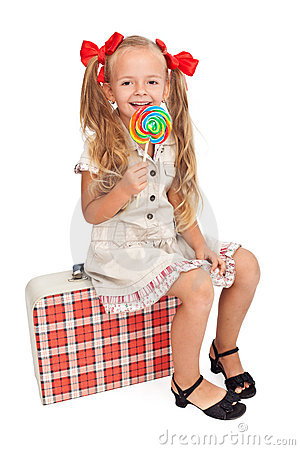 Girl with retro outfit and travel suitcase