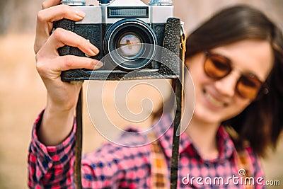 Girl with retro photo camera