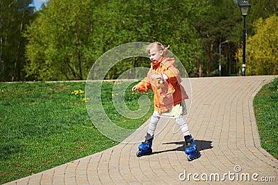 Girl rides on roller skates