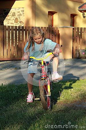 Girl riding the bicycle