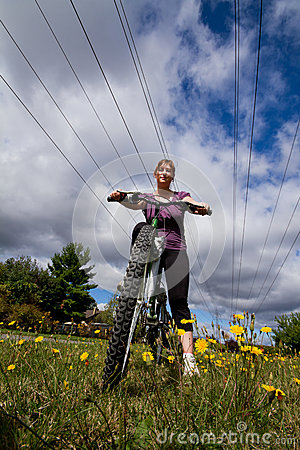 Girl Riding Bicycle in spring