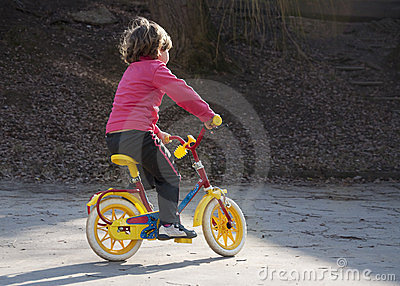 Girl riding first bike