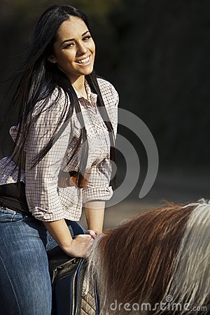 Girl riding on a horse