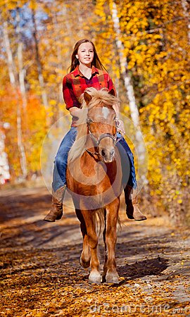 Free Girl Riding Horse In The Fall Time Royalty Free Stock Image - 44584576