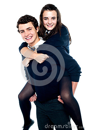 Free Girl Riding Piggyback And Embracing Boy Tightly Stock Image - 26978181