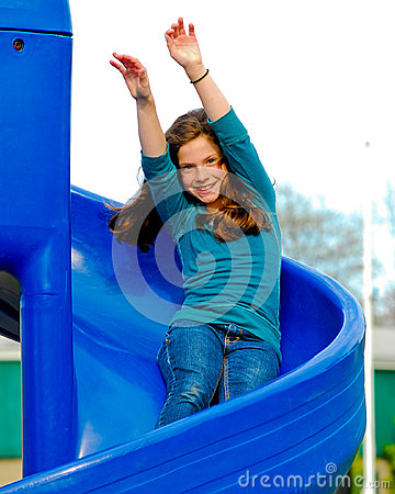 Girl riding a slide.