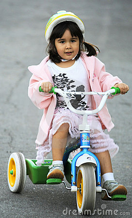 Free Girl Riding Tricycle Stock Image - 7773991