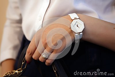 A ring with stones and a watch on the hand of a girl Stock Photo
