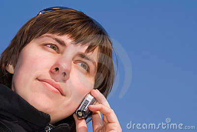 Girl rings on a mobile telephone