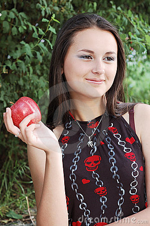 Girl with ripe red apple