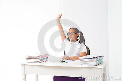 Girl rise her hand in class room