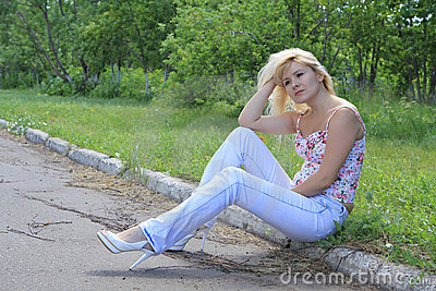 The girl on a road roadside thinks where to go