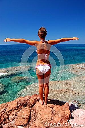 A girl on rocky beach