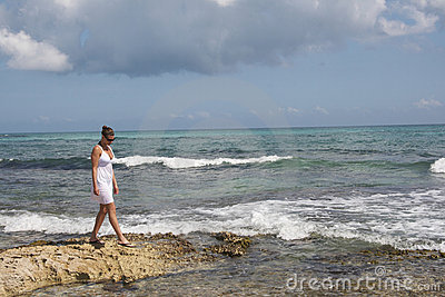 Girl on rocky shoreline