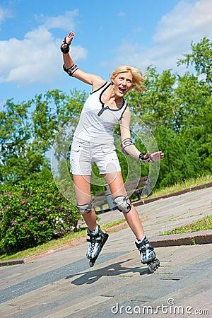 Girl roller-skating in the park