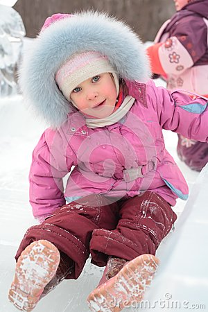Girl rolls down on ice slope